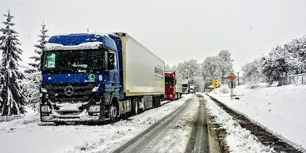 delivery trucks stuck in snow